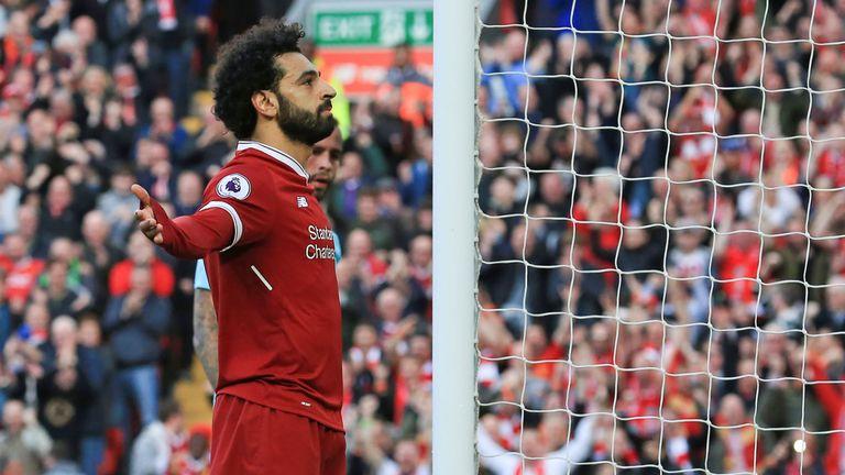 Mohamed Salah celebrates after making it 2-0