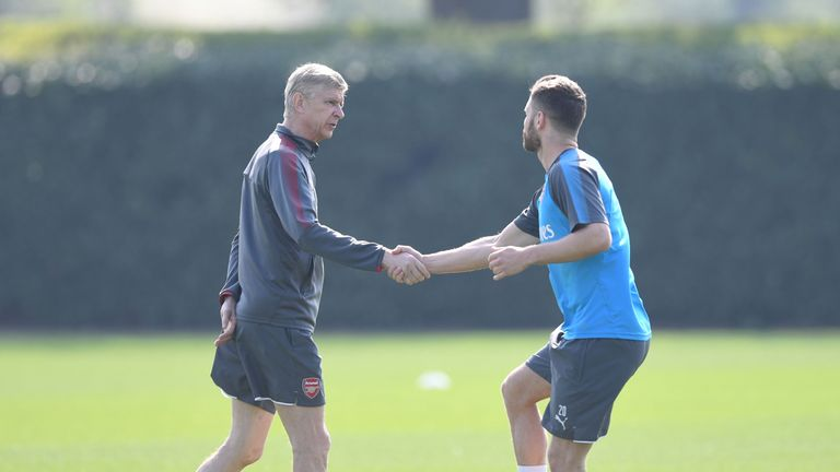 Wenger greets Mustafi at training after announcing he is set to leave
