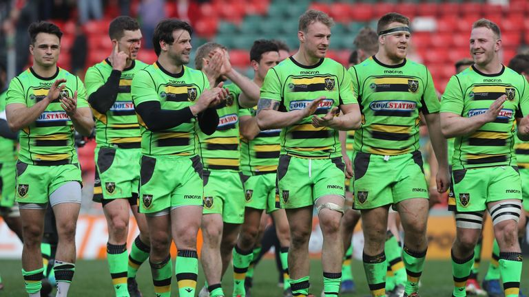 The Saints celebrate their victory at Welford Road