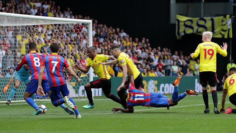 Wilfried Zaha hit the deck after a challenge from Adrian Mariappa when the teams met in the Premier League last season