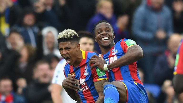 Patrick van Aanholt celebrates with Wilfried Zaha after making it 4-0