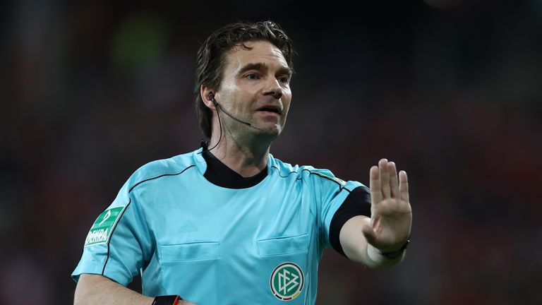 Referee Guido Winkmann referred a potential penalty to the video assistant referee.