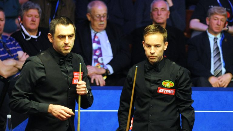 Ali Carter (right) is through to the quarter-finals of the World Snooker Championship after beating Ronnie O'Sullivan