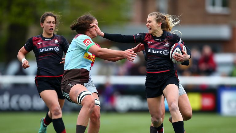 Clapp fends off Harlequins' Zoe Saynor as she breaks for the try-line