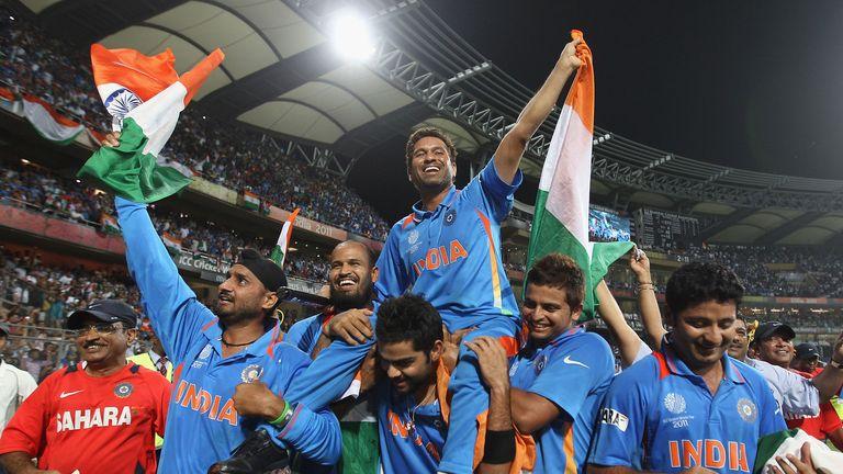 Sachin Tendulkar is carried aloft by his India team-mates in his native Mumbai