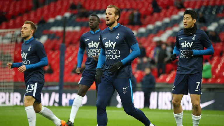 Harry Kane, wearing a Sky Ocean Rescue t-shirt, warms up at Wembley