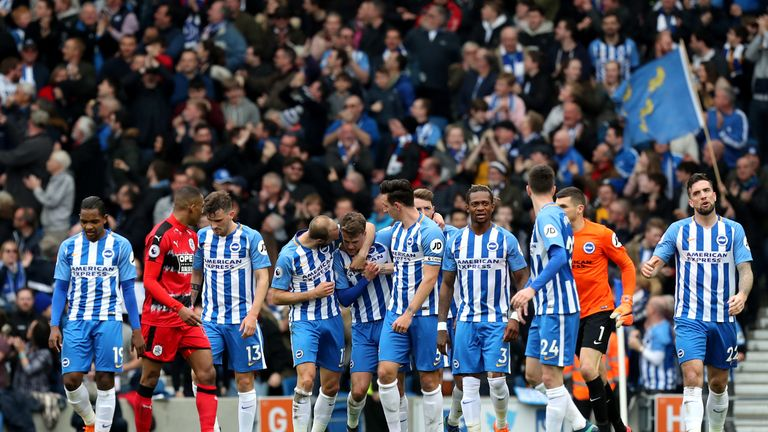 Solly March (centre) celebrates after his shot is deflected into his own net by Jonas Lossl