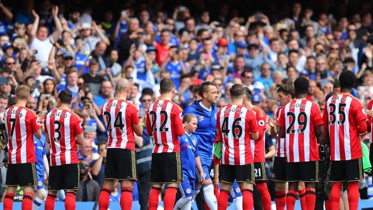 John Terry leads champions Chelsea through Sunderland's guard of honour at the end of last season