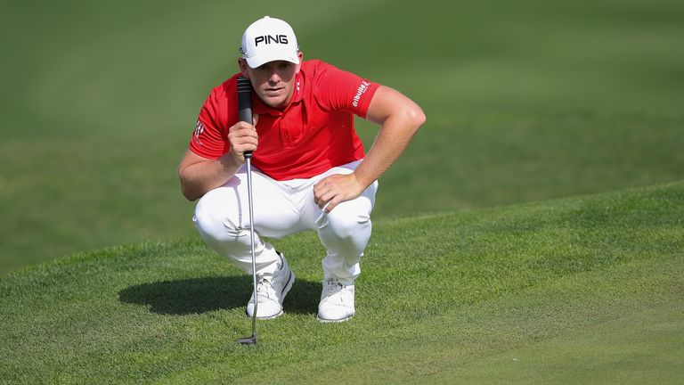 Wallace lines up a putt during his second round