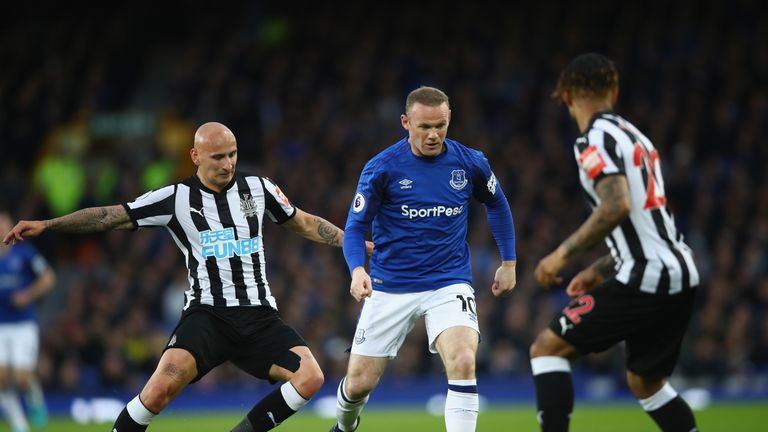 Wayne Rooney takes on Jonjo Shelvey in the first half