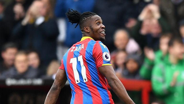 Wilfried Zaha celebrates after he scoring Crystal Palace's opening goal against Leicester City at Selhurst Park