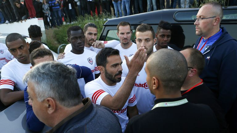 Ajaccio captain Yohann Cavalli tried to speak to Le Havre's players on their team bus