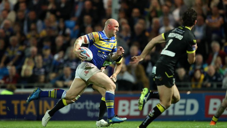 Carl Ablett powers away to score a try for Leeds against Warrington