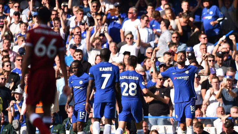 Olivier Giroud celebrates his winner against Liverpool with his Chelsea team-mates