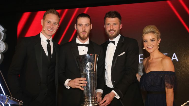 De Gea poses with his award alongside Dan Walker, Michael Carrick and Helen Skelton