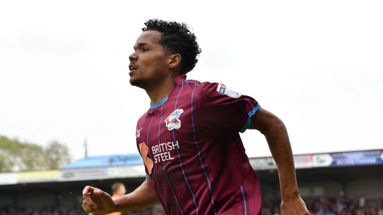 Duane Holmes celebrates after Rotherham's Michael Ihiekwe scores an own goal