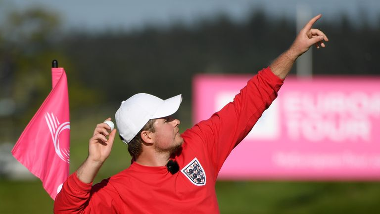 England's Eddie Pepperell throws his ball into the crowd