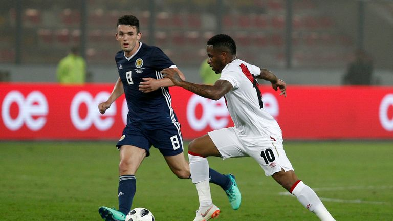 Farfan fights for the ball against John McGinn