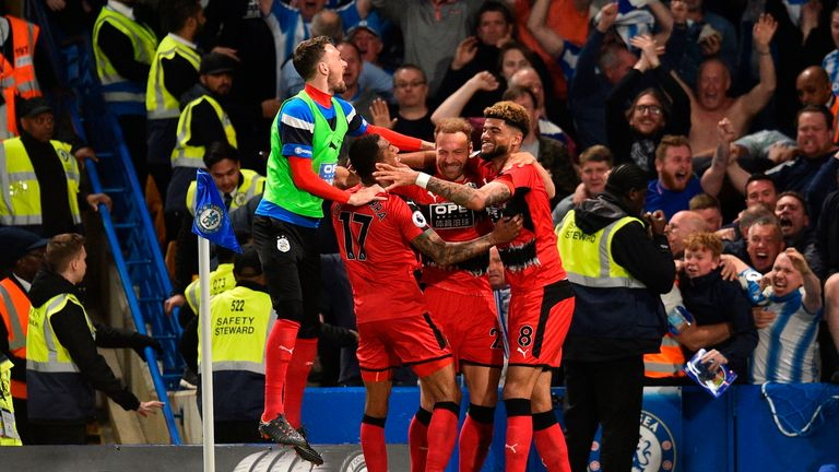 Huddersfield secured Premier League survival with a 1-1 draw at Chelsea on Wednesday