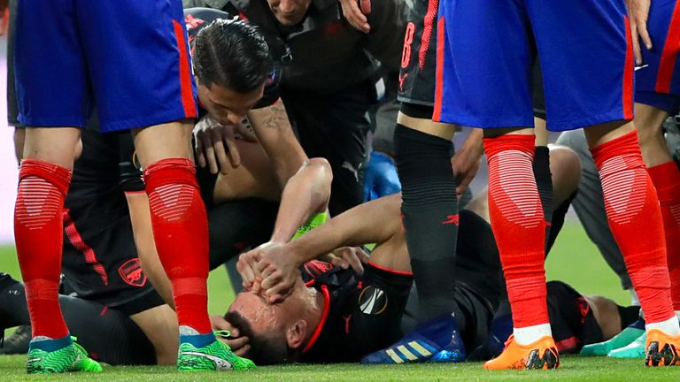 Arsenal's Laurent Koscielny receives medical attention at the Wanda Metropolitano