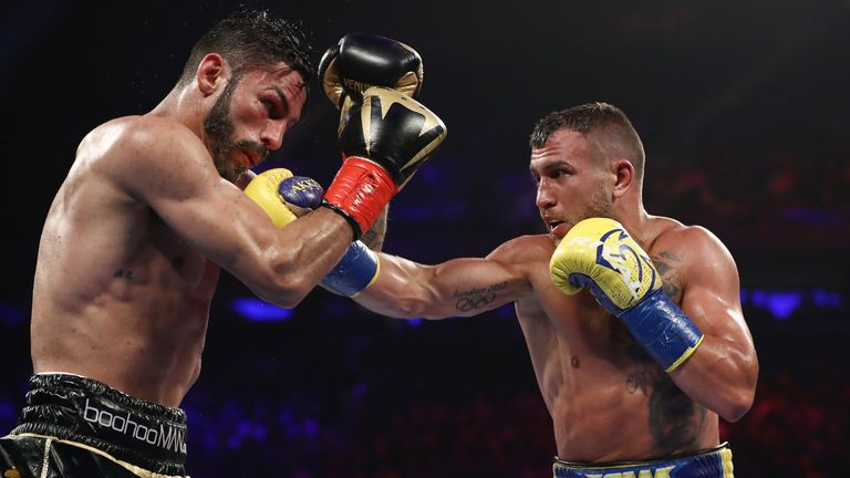 Lomachenko lands on Jorge Linares during their WBA lightweight title fight at Madison Square Garden in 2018