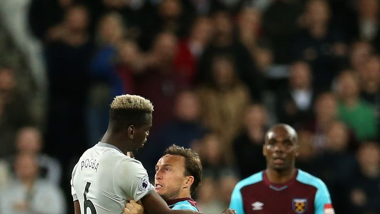 Mark Noble reacted angrily to a challenge from Paul Pogba in the second half