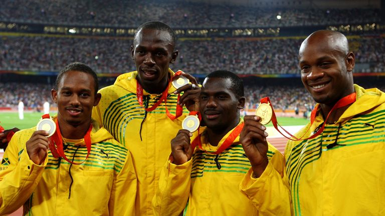 (L to R) Michael Frater, Usain Bolt, Nesta Carter and Asafa Powell celebrate their relay gold at the Beijing Olympics