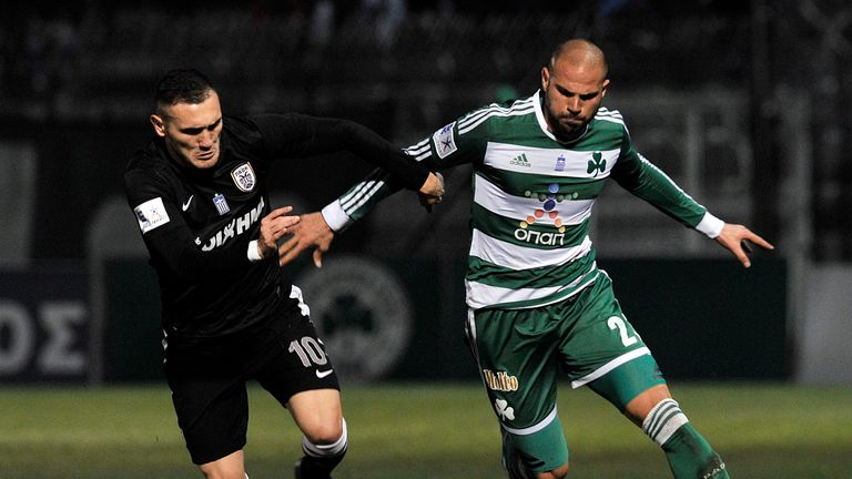PAOK 's Perez (left) in action before his move back to Spain in 2014