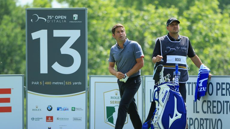 Robert Rock, with former European Tour pro Sam Walker on his bag, shares the first round lead
