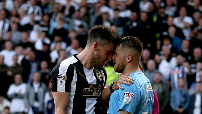 Notts County's Shaun Brisley (left) and Coventry's Marc McNulty go head to head