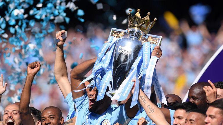 Vincent Kompany lifts last season's Premier League trophy