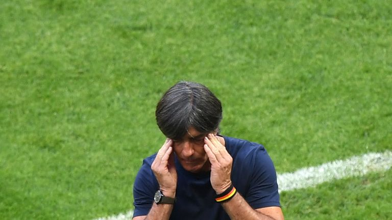 Joachim Low rubs his head during the 2-0 defeat to South Korea