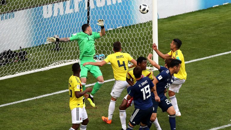 Osako (hidden) watches his header flash past Ospina to make it 2-1