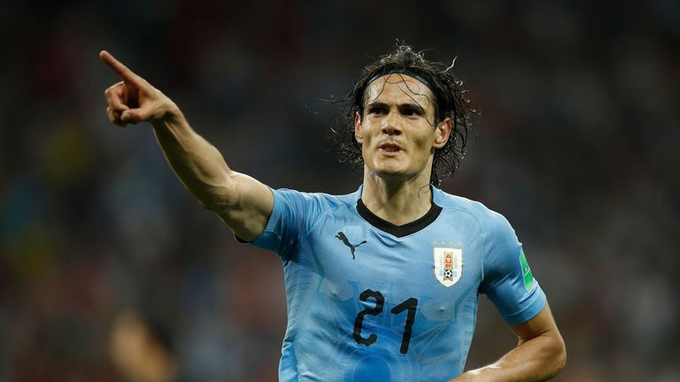 Edinson Cavani celebrates his second goal against Portugal