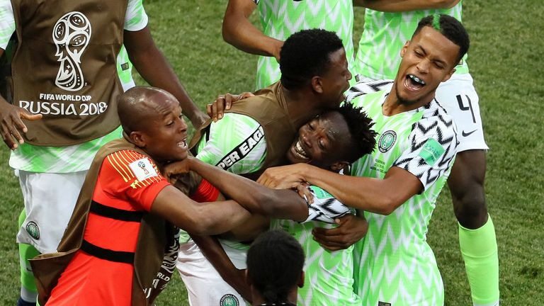 Musa celebrates his opener with team-mates