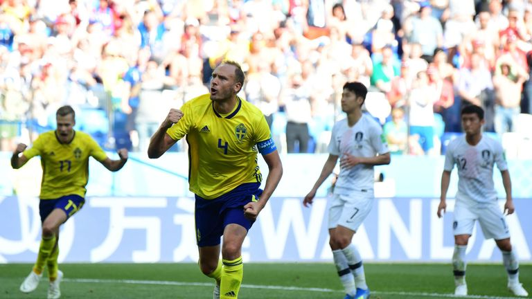 Andreas Granqvist celebrates after converting his penalty