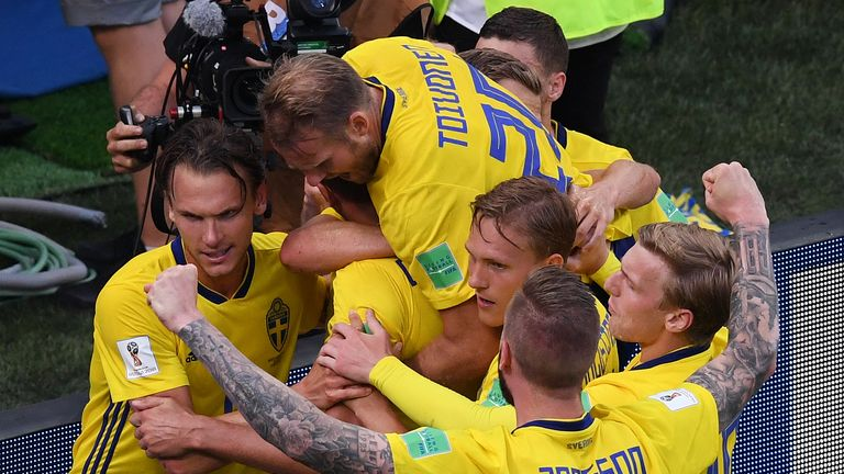 Sweden captain Andreas Granqvist is mobbed by teammates after putting them 1-0 up in their Group F encounter with South Korea