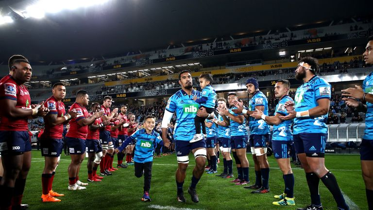 The Blues and Reds form a guard of honour for Jerome Kaino at Eden Park