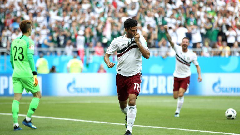 Carlos Vela celebrates as Mexico take a 1-0 lead