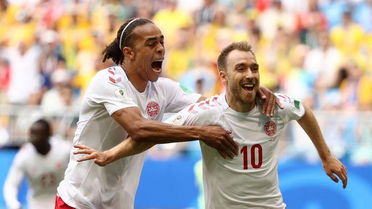 Christian Eriksen celebrates his goal with Yussuf Yurary Poulsen