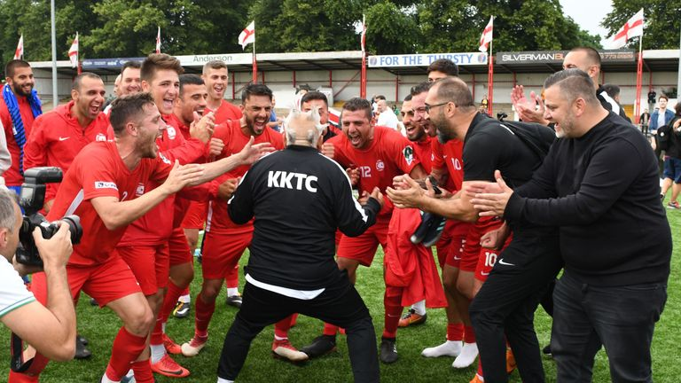 Northern Cyprus players and staff celebrate on the pitch after their 3-2 victory in the CONIFA World Football Cup semi-final