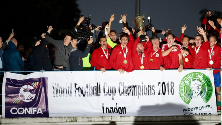 Karpatalya players celebrate with the trophy after victory over Northern Cyprus in the final of the CONIFA World Football Cup at Enfield (all images Con Chronis/CONIFA)
