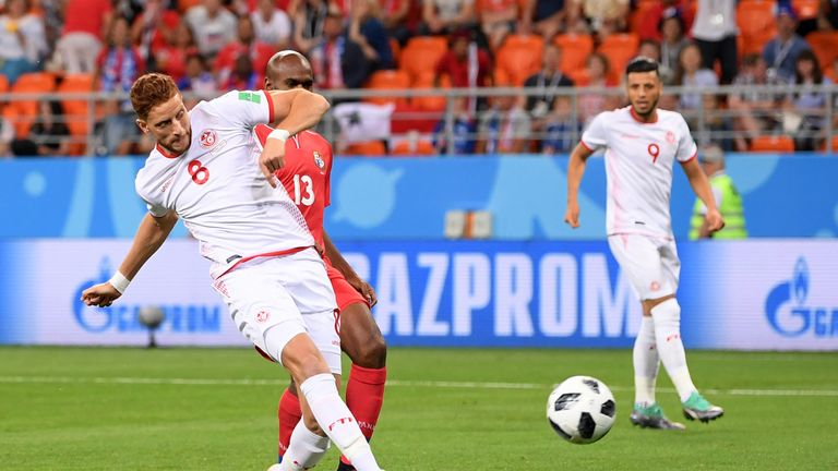 Fakhreddine Ben Youssef of Tunisia scores his team's first goal to level the match 1-1