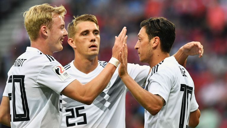 Mesut Ozil's Germany are the defending champions