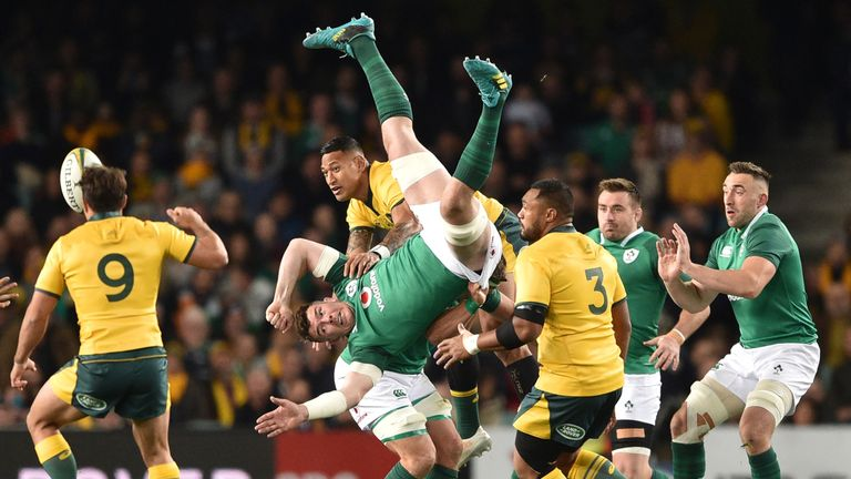 Australia's Israel Folau contests a high ball with Ireland's Peter O'Mahony
