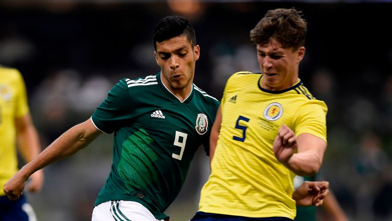 Jack Hendry (R) looks to win the ball