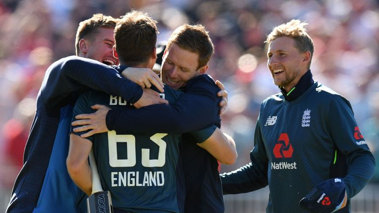 England players congratulate Jos Buttler after his match-winning century against Australia at Old Trafford