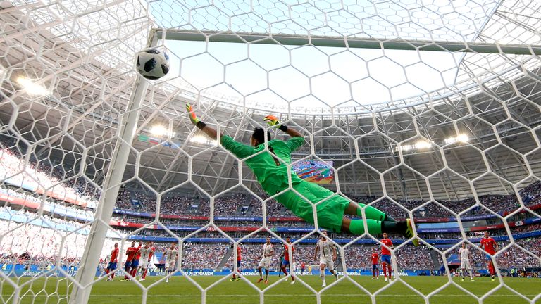 Keylor Navas is beaten by Aleksandar Kolarov's curling free kick