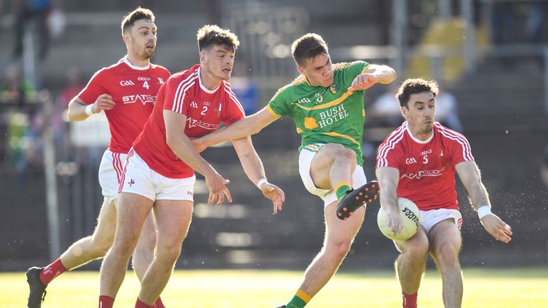 Darragh Rooney tries to get a shot away despite attention from Louth defenders
