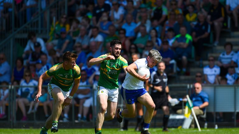 Conor McCarthy of Monaghan fends off Noel Plunkett of Leitrim